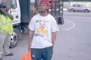 """A man sports a """"Silly faggots"""" T-shirt at an AIDS walk."""