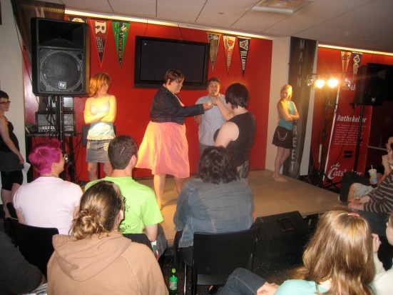 "Carmen Dioxide, Tess Tickle, Phil McCock and Allusion act out Mika ""Big Girl You Are Beautiful."""
