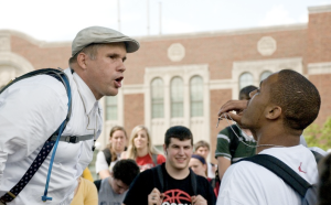 Brother Micah is confronted by a UC student. Photo from NewsRecord.org.