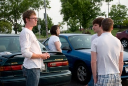 Attendees gather in a parking lot to carpool to Tabby's. Photo from NewsRecord.org.