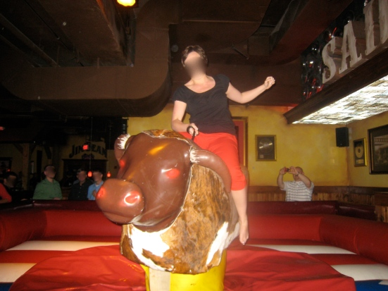 An attendee rides the mechanical bull.
