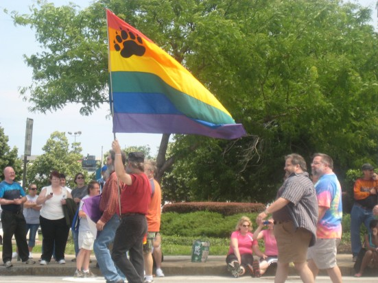A bear pride flag flies high during the parade that traveled through the heart of downtown Cleveland.