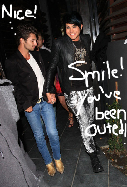 Adam Lambert comes out of the club with a man on his arm. Photo from PerezHilton.com.