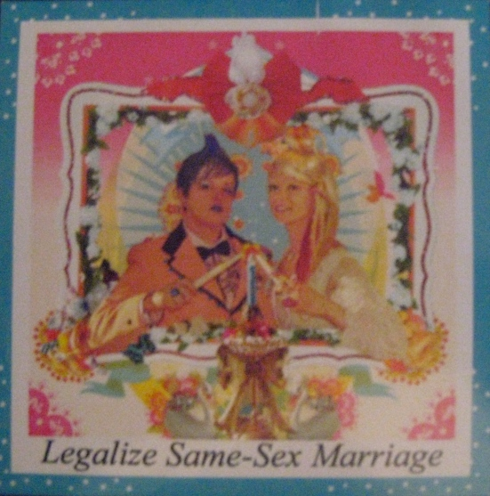 "The front features a couple lighting a unity candle with ""Legalize same-sex marriage: written underneath."