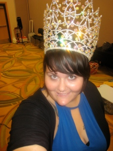 The Lady Jetta graciously allows me to try on one of her crowns.