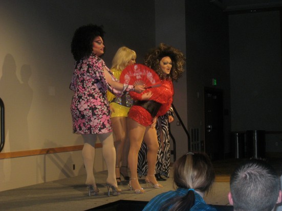 "Penny Tration, Sity Hall, the Lady Jetta and an attendee preform ""Lady Marmalade."""