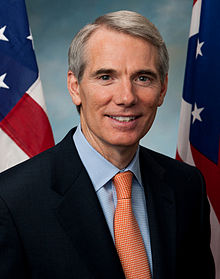 Photo: Ohio Sen. Rob Portman. Portrait of a white man with gray hair in a suit in front of Ohio and American flags. Photo source: Google Images 220px-Rob_Portman,_official_portrait,_112th_Congress