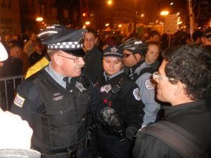 A police officer verbally spars with an Occupy Chicago protestor.