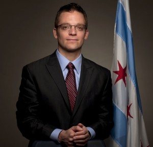 Photo: Chicago Alderman Joe Moreno, a white man with dark hair and glasses wearing a suit and tie. Photo source: Google Images