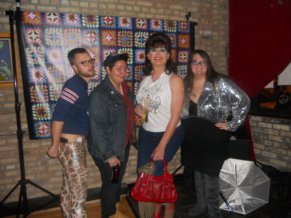 Photo: The Qu and me at the Roseanne Dance Party. Four people dressed like characters from the TV show Roseanne, wearing flannel, leggings and big hair. Google Images.