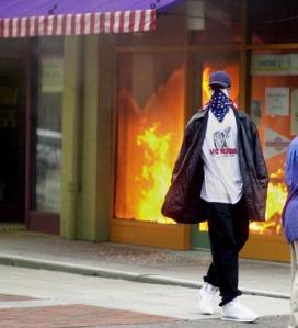 Photo: A store front burns during the Cincinnati race riots. Photo source: Cincinnati Enquirer, Google Images