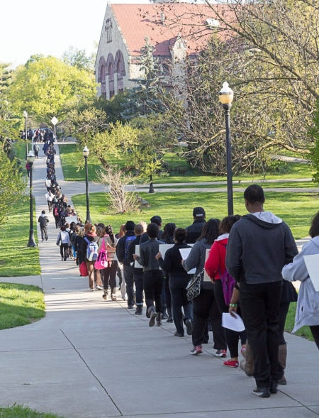 Photo: Approximately 200 Ohio State University community members march to a trustee board meeting in response to the recent hate crimes on and near campus. Photo source: Sam Cooler, Plunderbund, Google Images