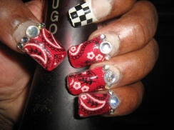 Photo: Nails painted red with bandana print on them. Flagging hanky code. Photo source: Google Images