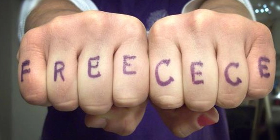 "Photo: White hands with ""Free CeCe"" written across them like knuckle tattoos. Google Images."