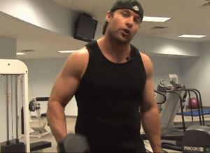 Photo: Dominic Dieter, a white younger man wearing a black tank top lifting weights. Photo source: Towleroad, Google Images