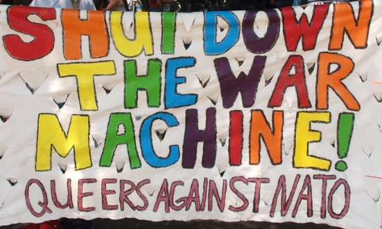 """Photo: Members of the queer contingent of the NATO protests carried a banner that reads: """"Shut down the war machin! Queers against NATO."""""""