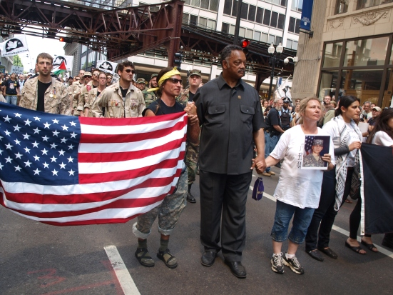 Photo: Civil rights activist Jesse Jackson and members of Iraq Veterans Against The War lead the march against the NATO Summit.
