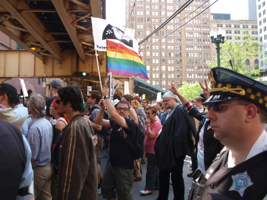 Photo: A protestor baits a police officer with a donut on a fishing pole.