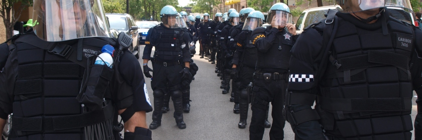 Photo: Police lined up in full riot gear at the Chicago NATO Summit protest. Google Images