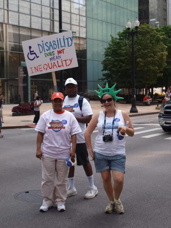 "Photo: Disability Pride Chicago: Members of the ALCU pose with a sign that reads, ""Disability does not mean inequality."" Google Images."