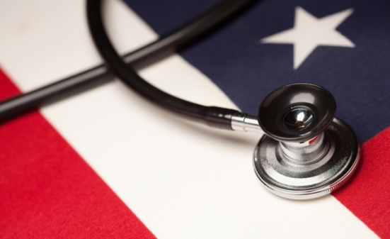 Photo: An American flag with a stethoscope laying on it for the Affordable Care Act, Obamacare, and health care reform. Photo source: Google Images