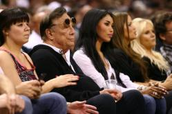 Photo: Donald Sterling sitting courtside at a Clipper's Game with his mistress and his wife. Photo Source: Google Images, TheRoot.com